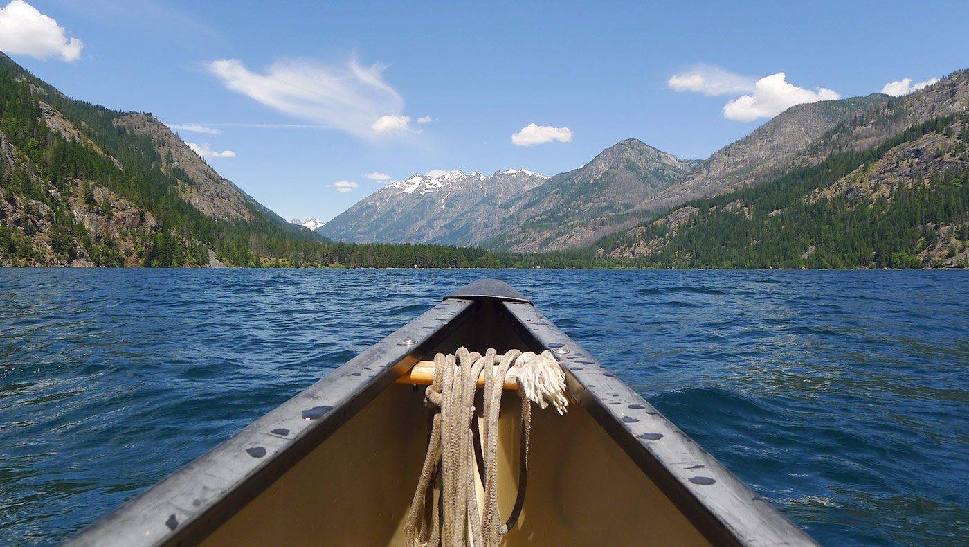 An idyllic destination for your next getaway | Canoe on Lake Chelan | Lodge at Stehekin