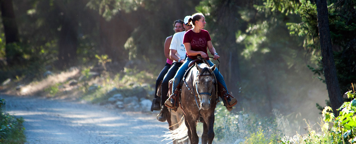Three people riding horses | North Cascades Lodge at Stehekin